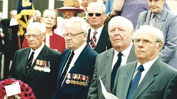 David Woodcock (second row, centre) next to Mrs George Bonello Du Puis at the 2003 memorial service with (front row, from left) the three survivors from HMS Glorious, Kenneth Cleave, Harry Hoose and Joe Brown, next to Malta's High Commissioner to the UK George Bonello Du Puis.