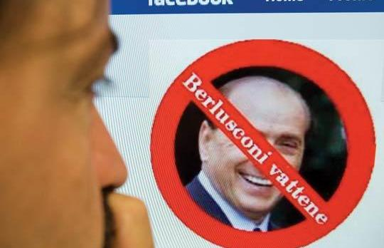 A man views a Facebook web page for a group called Uccidiamo Berlusconi ('Let's kill Berlusconi') in Rome.