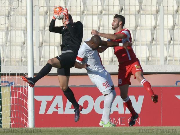 Valletta's Romeu Romao (centre) tries to block Naxxar's Ishmael Grech as Valletta goalkeeper Henry Bonello (left) makes a save at the National Stadium in Ta'Qali on September 27. Photo: Matthew Mirabelli