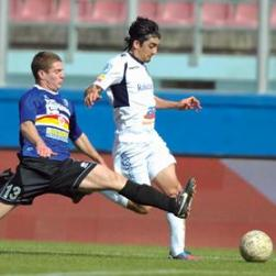 Sliema's Matias Muchardi races past Ryan Sammut, of Tarxien. Photo: Matthew Mirabelli