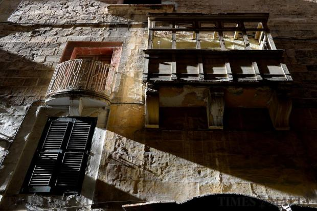 A weathered balcony is lit by the afternoon sun in Strait Street, Valletta on February 13. Photo: Matthew Mirabelli