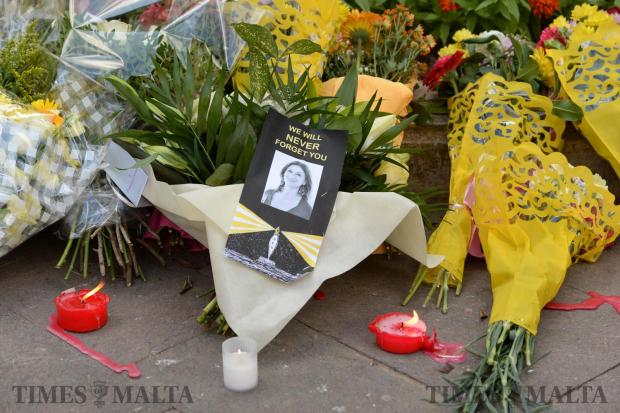 Flowers and tributes lay at the foot of the Great Siege monument in Valletta on October 19, which has been turned into a temporary shrine for the journalist Daphne Caruana Galizia who was killed by a car bomb outside her home in Bidnjia on October 16. Photo: Matthew Mirabelli