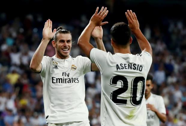 Gareth Bale celebrates his goal with Real Madrid team-mate Marcos Asensio.
