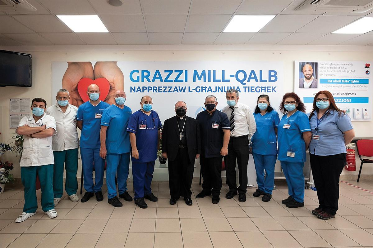 The archbishop with the staff at the Blood Transfusion Centre.