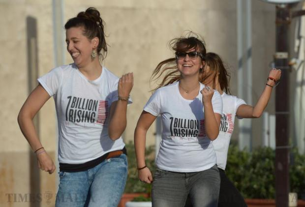 Activists participate in a flash mob at Tigne Point in Sliema on February 14, to mark One Billion Rising, a global movement to end rape and sexual violence against women. Photo: Matthew Mirabelli