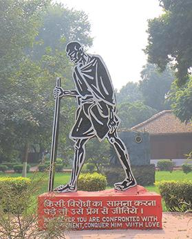 Statue of Mahatma Gandhi at his Ashram at Ahmedabad, India. Photo: Anandoart/Shutterstock