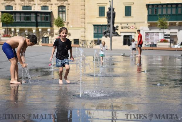 Children play in a fountain in St George's Square in Valletta on May 28. Photo Mark Zammit Cordina