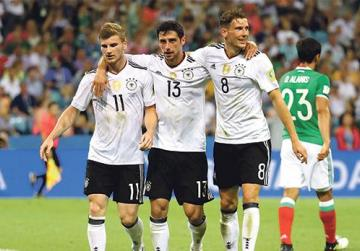 Germany players celebrate after scoring against Mexico in yesterday's semi-final.