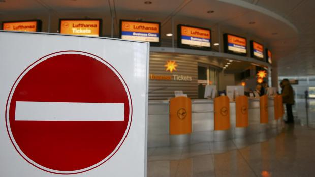 Closed check-in desks are seen during a pilots strike of German airline Lufthansa at Munich airport.
