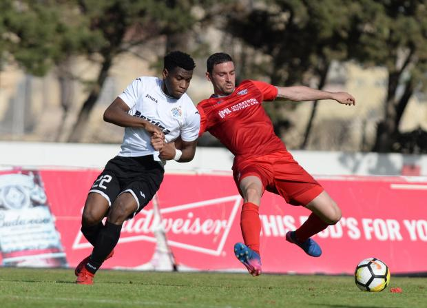Balzan's Ryan Fenech (right) keeps the ball away from Hibernians, Joseph Mbong during their Premier League match at the Hibernian's Stadium in Paola on April 21. Photo: Matthew Mirabelli