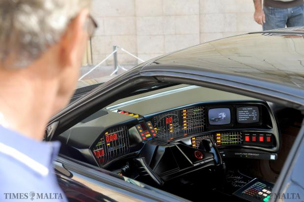 A man stares into the cockpit of a replica of the Knight Rider 2000, the high tech gadget car used in the popular 80's tv series Knight Rider starring David Hasselhoff. The car was on display at a car show in Luqa's Main Square on November 30. Photo: Chris Sant Fournier