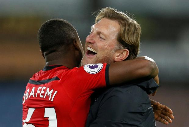 Southampton manager Ralph Hasenhuttl celebrates after the match with Michael Obafemi.