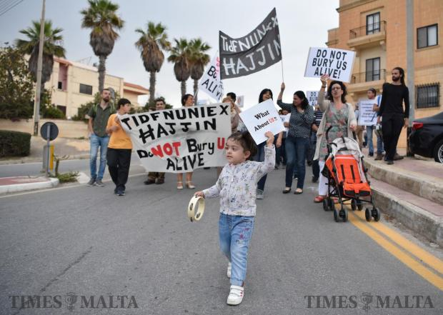 Protestors walk in the streets of Pembroke objecting to the proposed new hotel development on May 16. Photo: Mark Zammit Cordina