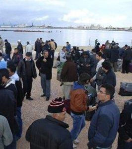 Workers await evacuation in Benghazi.