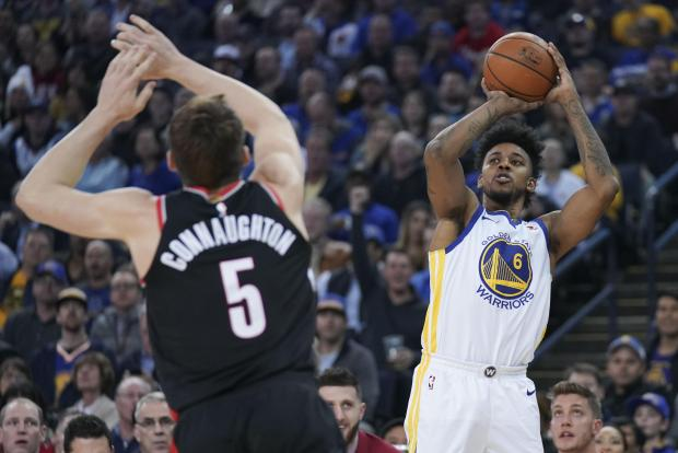 Golden State Warriors guard Nick Young (6) shoots the basketball against Portland Trail Blazers guard Pat Connaughton (5) during the first quarter at Oracle Arena. Photo: Kyle Terada-USA TODAY Sports.