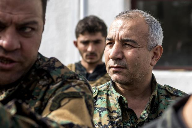 US-backed Syrian Democratic Forces (SDF) assault's overall commander Jia Furat (C) answers the press near the Omar oil field in the eastern Syrian Deir Ezzor province.
