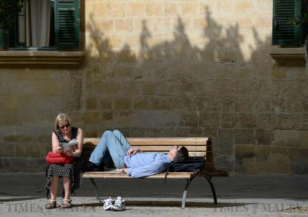 A couple relax on a bench in Piazza Regina in Valletta on April 18. Photo: Matthew Mirabelli