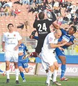 Valletta goalkeeper Andrew Hogg rises high to intercept a Sliema attack. Photo: Jason Borg