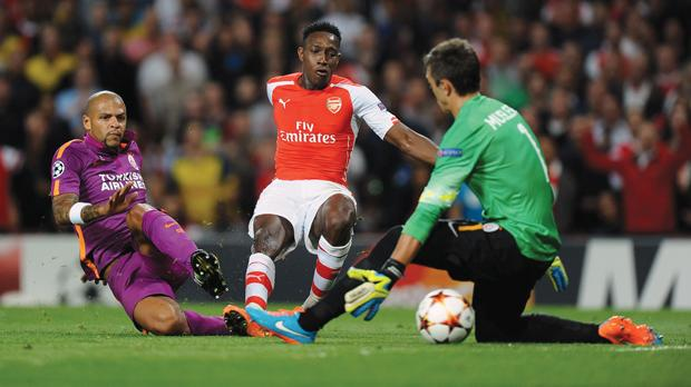 Arsenal's Danny Welbeck (centre) scores his side's first goal at the Emirates Stadium, yesterday.