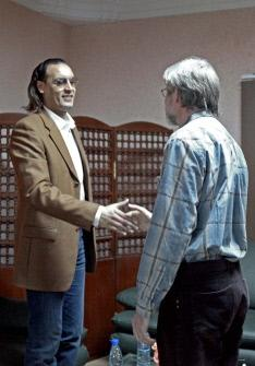 The eldest son of Libayan leader Muammar Gaddafi, Hannibal (L), shakes hands with jailed Swiss businessman Max Goeldi at Al-Jadaida prison on the outskirts of Tripoli. (AFP)