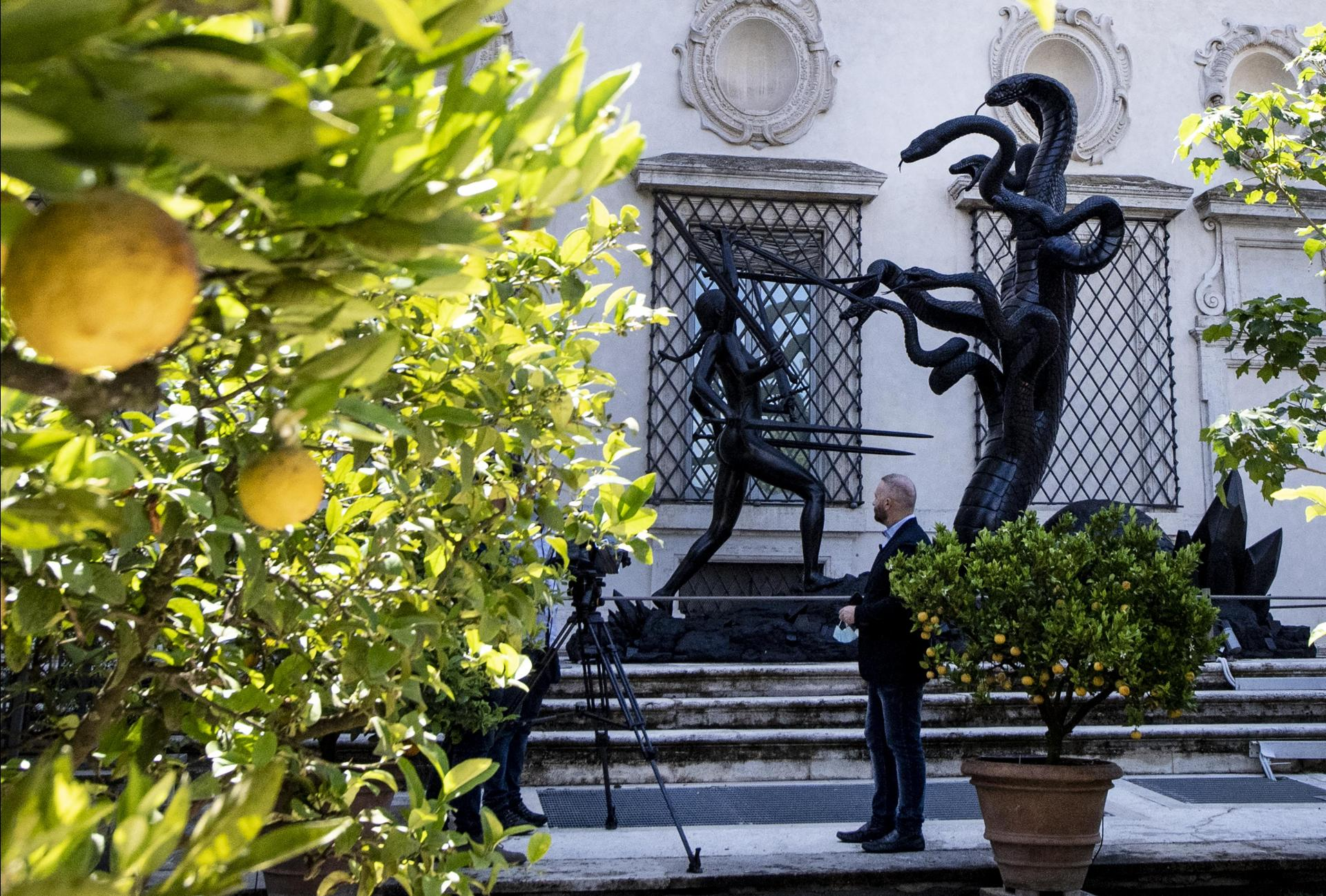 Outside on the terrace, Hirst's towering sculpture 'Hydra and Kali overlooks the citrus trees.