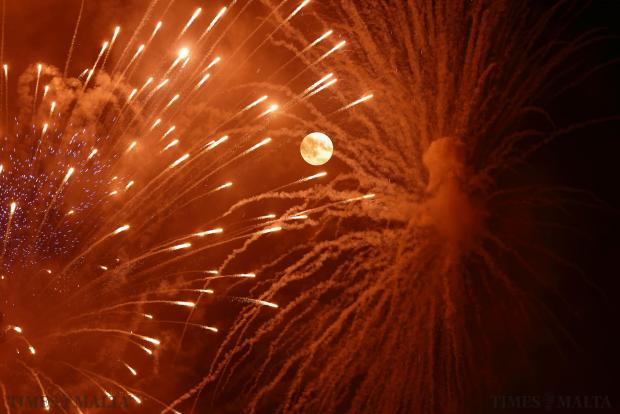 Fireworks explode in front of the supermoon on the outskirts of Mosta on August 10, celebrating the feast Our Lady of the Assumption which is commemorated on August 15. The astronomical event occurs when the moon is closest to the Earth in its orbit, making it appear much larger and brighter than usual. Photo: Darrin Zammit Lupi