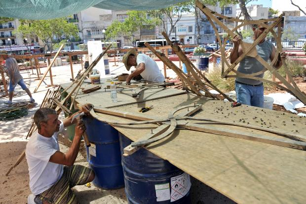 Firework specialists prepare ground fireworks ahead of the Msida feast on July 17. Photo: Chris Sant Fournier