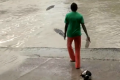 Woman warns off crocodile with her flip flop