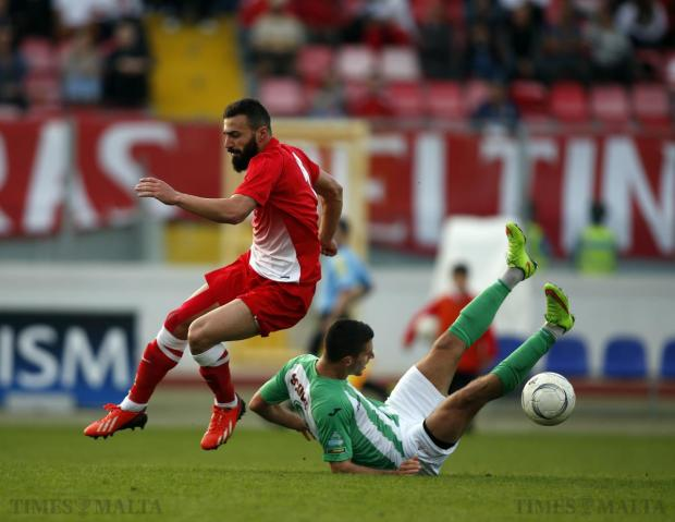 Floriana's Vito Plut (right) loses his balance after a tussle for possession with Valletta's Steve Borg (left) during their Premier League football match at the National Stadium in Ta' Qali on December 6. Photo: Darrin Zammit Lupi