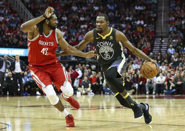 Golden State Warriors forward Kevin Durant (35) dribbles the ball as Houston Rockets center Nene Hilario (42) defends during the fourth quarter at Toyota Center. Photo: Troy Taormina-USA TODAY Sports