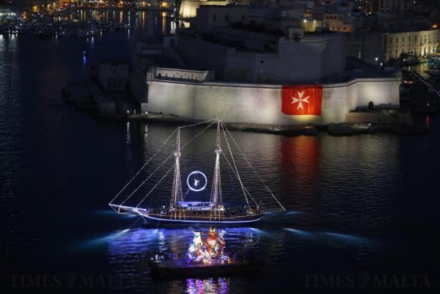The Turkish gullet Fernandes and a carnival float parade during the Valletta Pageant of the Seas in front of Fort St Angelo in Grand Harbour on June 7. The event was part of the Valletta 2018 festivities to mark the 450th anniversary since Valletta's foundation. Photo: Darrin Zammit Lupi