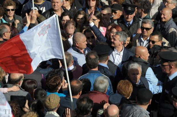 Opposition leader Simon Busutill makes his way through the crowd in Valletta after arriving at a demonstration calling for the resignation of the Prime Minister and two members of the government following the Panama Papers leak scandal outside Castille in Valletta on April 10. Photo: Matthew Mirabelli