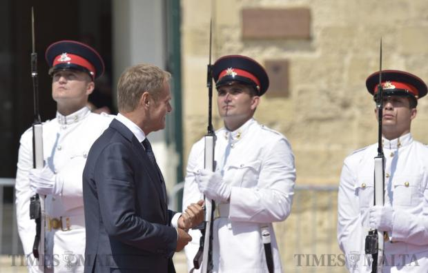EU council President Donald Tusk walks by Armed Forces soldiers as he arrives at Auberge de Castille for talks with Prime Minister Joseph Muscat in Valletta on September 12.