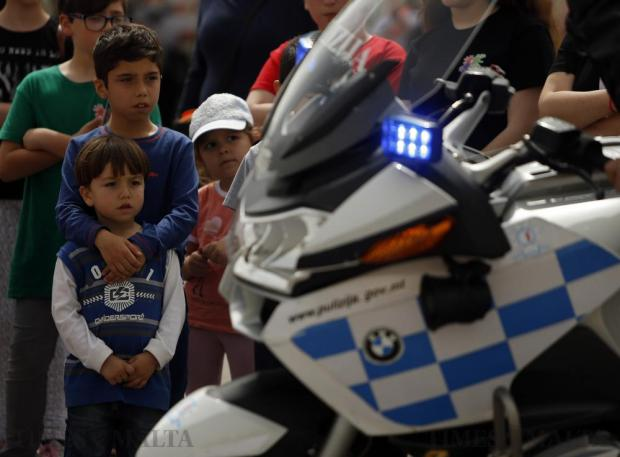 Children look at police motorcycles during an event organised by the Zejtun local council for youngsters to educate them about roadside safety and traffic flows, in Zejtun on April 23. Photo: Darrin Zammit Lupi