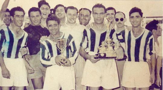 Sliema Wanderers players (from left) Camilleri, Gejtu Sacco, Tony Nicholl and Ninu Calleja celebrate winning the FA Trophy in 1952.