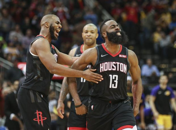 Houston Rockets guard James Harden (13) celebrates with guard Chris Paul (3) after scoring a basket during the fourth quarter against the Los Angeles Lakers at Toyota Center. Mandatory Credit: Troy Taormina-USA TODAY Sports