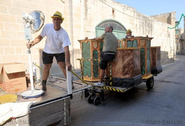 A trailer loaded with village feast decorations passes through a Lija street on August 9. Photo: Chris Sant Fournier