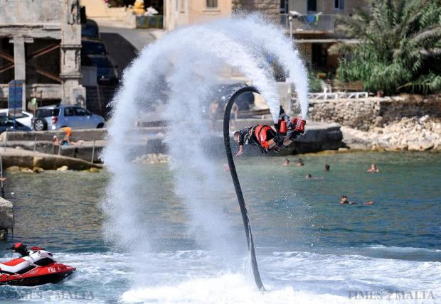 A man somersaults on board a fly board in Spinola Bay on July 29. Photo: Chris Sant Fournier
