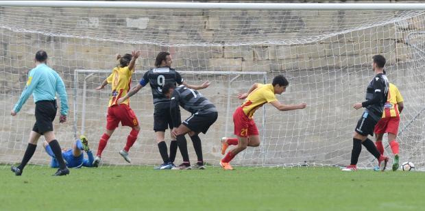 Augusto Caseres (no.21) scores Senglea Athletic's first goal. Photo: Matthew Mirabelli