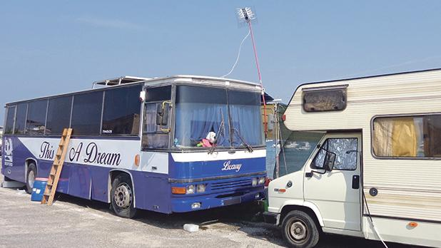Not everybody's dream, a 'luxury' coach complete with TV antenna is taking up space as a temporary seaside home at Little Armier Bay. Photo: Anne Zammit