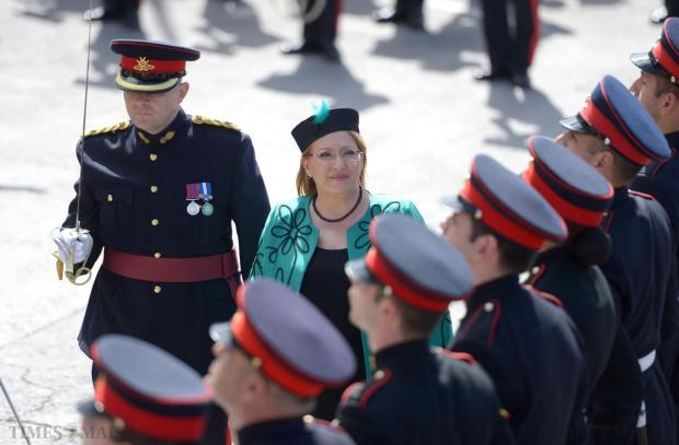 President of Malta, Marie Louise Coleiro Preca inspects the Guard of Honour before laying flowers on the Freedom Day Monument in Vittoriosa on March 31. Photo: Matthew Mirabelli