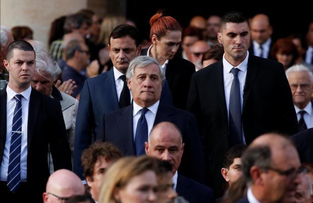 Antonio Tajani (centre) attending Daphne Caruana Galizia's funeral last November.