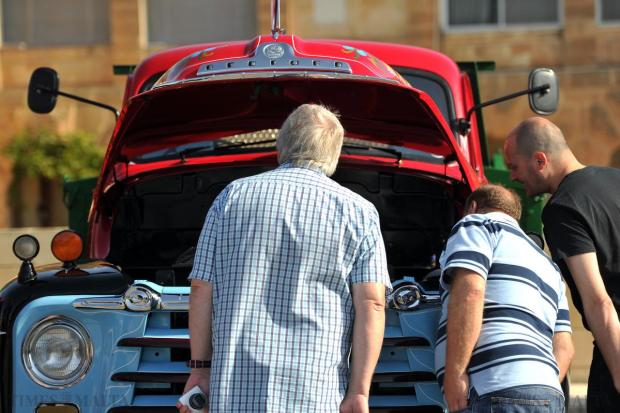 Enthusiasts view the engine of a truck that took part in the Malta Classic Commercial Vehicle Road Run on April 26. Photo: Jason Borg