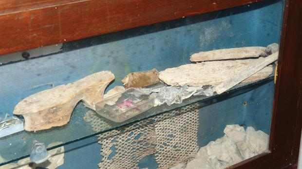 The worn-out display box containing the findings from the secret passages.