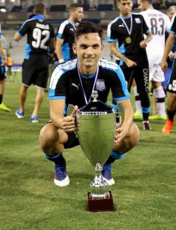 Andre Schembri poses with the Cypriot Super Cup.