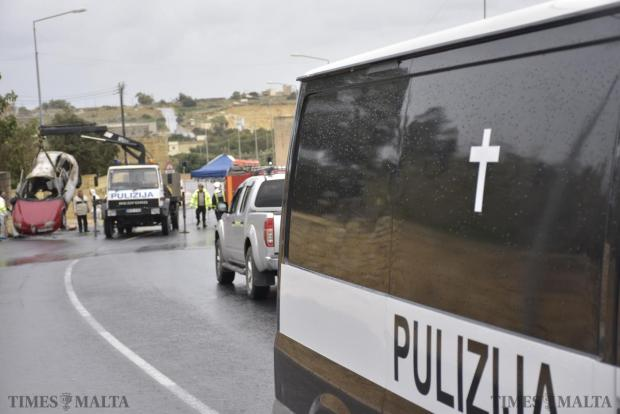 The body of Martin Cachia leaves the scene in Marsascala where a bomb exploded inside his red Alfa Romeo on January 16 killing him. Photo: Mark Zammit Cordina
