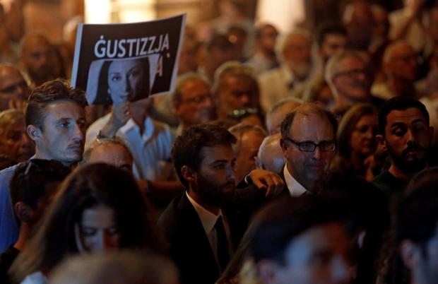 Peter Caruana Galizia and his son Matthew attend a vigil and protest on the first anniversary of the assassination of their wife and mother. Photo: Reuters