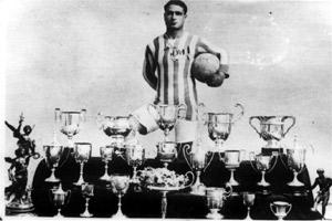 Guzè Alamango with the trophies he won during his time with Floriana.