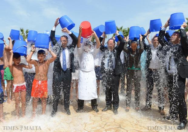 Westin Dragonara general manager, Michael Camilleri Kamsky (right of red bucket), and staff pour ice cold water over themselves on August 22, after being nominated by their friends at Hilton Malta for the ALS challenge. In turn, they nominated Tourism Minister Edward Zammit Lewis, Air Malta CEO Louis Giordimaina and Starwood Hotels vice president Robert Koren. The challenge is helping raise awareness of amyotrophic lateral sclerosis, a disease of the nervous system. Photo: Matthew Mirabelli