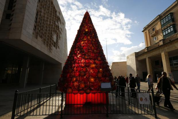 A Christmas tree made of some 2000 glass baubles is backlit by the sun at City Gate in Valletta on December 21. Photo: Darrin Zammit Lupi
